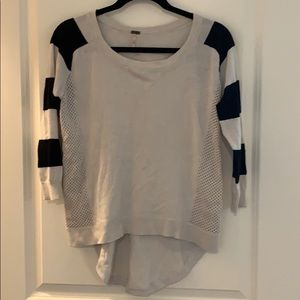 Striped sleeves, hi low fit, button detail sweater